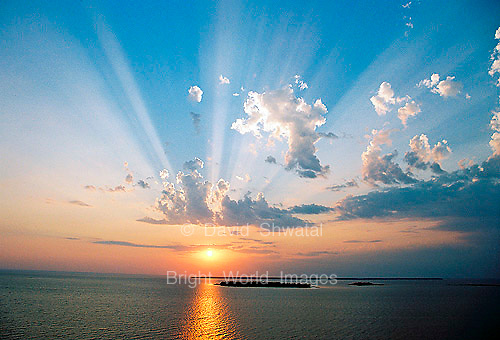 Sunlight beams over a lake and an island in Green Bay, Lake Michigan, Door County, Wisconsin
