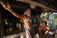 January 28th, 2008_Kerala State, India_ A man sells drinks and snacks in a small shop located on the banks of the backwaters of the Southern Indian state of Kerala.  The waterways are a signature attraction in Kerala and are also an important link for communities and commerce there.  Photographer: Daniel J. Groshong/Tayo Photo Group