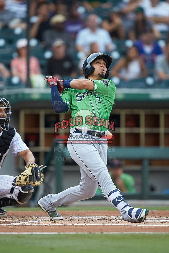 Rafael Ortega (5) of the Gwinnett Braves follows through on his swing against the Charlotte Knights at BB&T BallPark on July 12, 2019 in Charlotte, North Carolina. The Stripers defeated the Knights 9-3. (Brian Westerholt/Four Seam Images)