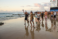 Snapper Rocks, Coolangatta, Queensland Australia. (Tuesday March 11, 2014) Gabriel's father Charles Medina (BRA) running to greet his son after the win.–  The swell  was in the 3'-6' range all day and the Quiksilver Pro was completed right on dark with Gabriel Medina (BRA) defeating local favourite Joel Parkinson (AUS) in the 35 minute final. Photo: joliphotos.com