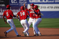 Auburn Doubledays Kelvin Gutierrez (5), Melvin Rodriguez (16) and David Kerian (21) celebrate with Diomedes Eusebio (31) after a walk off base hit during a game against the Batavia Muckdogs on September 7, 2015 at Falcon Park in Auburn, New York.  Auburn defeated Batavia 11-10 in ten innings.  (Mike Janes/Four Seam Images)