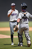 Winston-Salem Dash pitcher Bennett Sousa (22) and catcher Evan Skoug (19) celebrate after closing out a Carolina League game against the Carolina Mudcats on August 14, 2019 at Five County Stadium in Zebulon, North Carolina.  Winston-Salem defeated Carolina 4-2.  (Mike Janes/Four Seam Images)