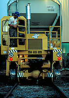 Workman prepares to move chemical hopper car with a track mobile. Orange Texas USA.