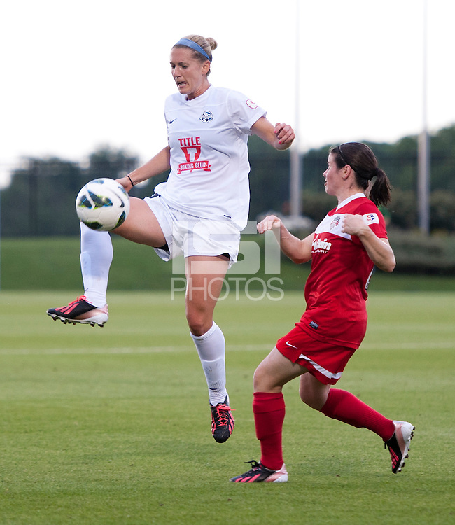 Jen Buczkowski (6) of FC Kansas City takes control of the ball in front of Diana Matheson (8) of the Washington Spirit at the Maryland SoccerPlex in Boyds, MD. The Washington Spirit tied FC Kansas City, 1-1.