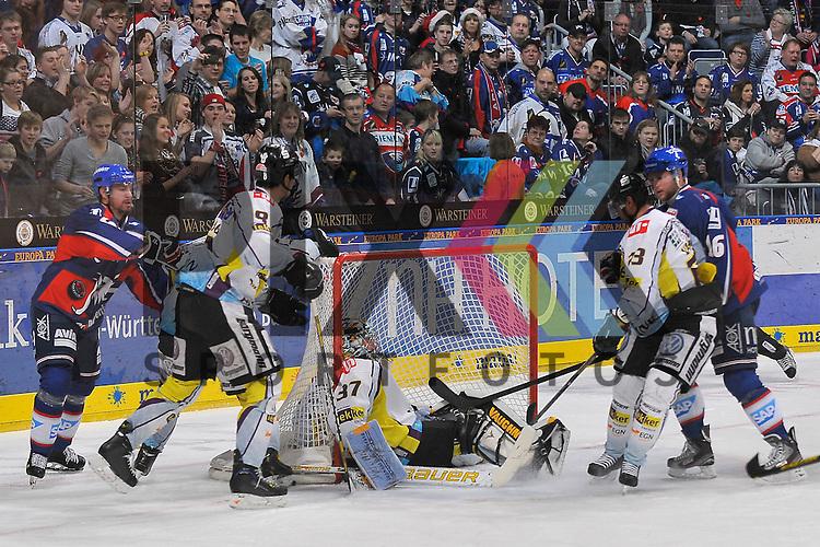 Sitzend im Tor Krefelds Scott Langkow (Nr.37) links sind Mannheims Jochen Hecht (Nr.55) gegen Krefelds Mitja Robar (Nr.51) und Krefelds Patrick Kloepper (Nr.9) und rechts sind Mannheims Mike Glumac (Nr.16) gegen Krefelds Herberts Vasiljevs (Nr.23)  beim Spiel in der DEL, Adler Mannheim - Krefeld Pinguine.<br /> <br /> Foto &copy; Ice-Hockey-Picture-24 *** Foto ist honorarpflichtig! *** Auf Anfrage in hoeherer Qualitaet/Aufloesung. Belegexemplar erbeten. Veroeffentlichung ausschliesslich fuer journalistisch-publizistische Zwecke. For editorial use only.