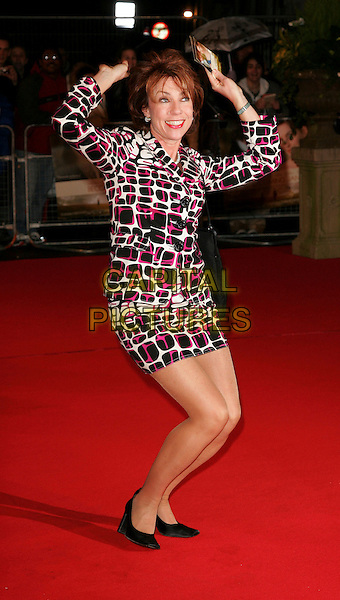 """KATHY LETTE.At the World Premiere of """"Becoming Jane"""" at the Odeon West End Cinema, Leicester Square, London, England,.March 4th 2007..full length pink cream and black print dress bag over head raining funny.CAP/ROS.©Steve Ross/Capital Pictures."""