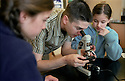 Fifth-graders at TOPS K-8 learn how to use a microscope.