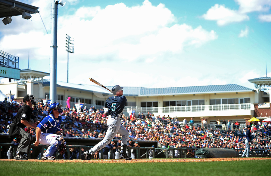 Mar. 10, 2010; Tempe, AZ, USA; Seattle Mariners designated hitter Mike Sweeney hits a three run double in the fourth inning against the Texas Rangers during a spring training game at Surprise Stadium. Mandatory Credit: Mark J. Rebilas-