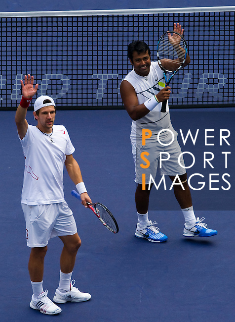 SHANGHAI, CHINA - OCTOBER 17:  Jurgern Melzer of Austria and Leander Paes of India acknowledge the crowd after their victory over Mariusz Fyrstenberg and Marcin Matkowski of Poland on their doubles final during day seven of the 2010 Shanghai Rolex Masters at the Shanghai Qi Zhong Tennis Center on October 17, 2010 in Shanghai, China.  (Photo by Victor Fraile/The Power of Sport Images) *** Local Caption *** Jurgern Melzer; Leander Paes