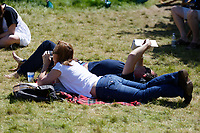 Pictured: People loung on the festival green.<br /> Re: Hay Festival at Hay on Wye, Powys, Wales, UK. Saturday 02 June 2018