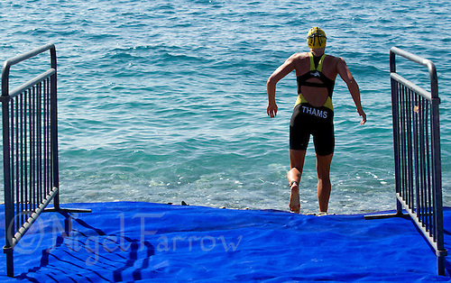 16 SEP 2012 - NICE, FRA - Line Bork Thams of Noyon Puissance 3 runs into the water for a warm up swim before the start of the French Grand Prix triathlon series final stage held during the Triathlon de Nice Côte d'Azur (PHOTO (C) 2012 NIGEL FARROW)