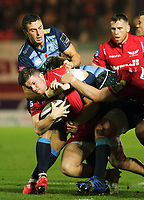 Steffan Evans of the Scarlets (with ball) tackled to the ground during the Guinness PRO14 match between Scarlets and Cardiff Blues at Parc Y Scarlets Stadium, Llanelli, Wales, UK. Saturday 28 October 2017