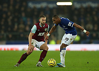 26th December 2019; Goodison Park, Liverpool, Merseyside, England; English Premier League Football, Everton versus Burnley; Djibril Sidibe of Everton passes the ball under pressure from Charlie Taylor of Burnley - Strictly Editorial Use Only. No use with unauthorized audio, video, data, fixture lists, club/league logos or 'live' services. Online in-match use limited to 120 images, no video emulation. No use in betting, games or single club/league/player publications