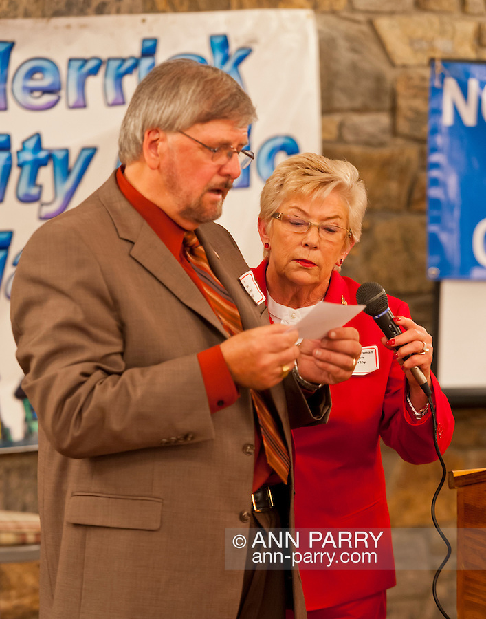 Oct. 23, 2012 - Merrick, New York, U.S. - Congresswoman CAROLYN MCCARTHY (D) in red suit, and JOE BAKER, President of South Merrick Community Civic Association, read question from audience member at the 4th Annual Meet the Candidate Night held by Merrick civic associations, with many in the area in a new congressional district.