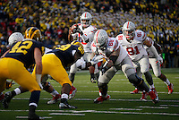 Ohio State Buckeyes quarterback J.T. Barrett (16) tacked a snap during the fourth quarter of the NCAA football game against the Michigan Wolverines at Michigan Stadium in Ann Arbor on Nov. 28, 2015. Ohio State won 42-13. (Adam Cairns / The Columbus Dispatch)