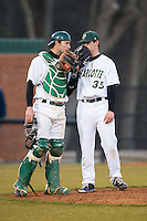 Charlotte 49ers catcher Nick Daddio (20) has a meeting on the mound with relief pitcher Jacob Craver (35) during the game against the Rice Owls at Hayes Stadium on March 6, 2015 in Charlotte, North Carolina.  The Owls defeated the 49ers 4-2.  (Brian Westerholt/Four Seam Images)