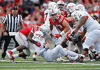 Ohio State Buckeyes defensive lineman Adolphus Washington (92) sacks Northern Illinois Huskies quarterback Drew Hare (12) in the third quarter of the college football game between the Ohio State Buckeyes and the Northern Illinois Huskies at Ohio Stadium in Columbus, Saturday afternoon, September 19, 2015. The Ohio State Buckeyes defeated the Northern Illinois Huskies 20 - 13. (The Columbus Dispatch / Eamon Queeney)