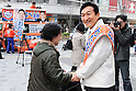 March 25, 2011, Tokyo, Japan - Japanese business entrepreneur Miki Watanabe, running for governor of Tokyo, shakes hands with pedestrians in front of Tokyo's Yurakucho railroad station on Friday, March 25, 2011. Watanabe, the founder of a chain of casual pubs, is running in the April 10 election, attempting to make the big jump from business manager to big-time politician. (Photo by AFLO) [3906] -mis-