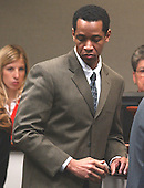 Sniper suspect John Allen Muhammad walks back to the defense table after a conference at the bench during his trial in courtroom 10 at the Virginia Beach Circuit Court in Virginia Beach, Virginia on October 28, 2003. <br /> Credit: Adrin Snider - Pool via CNP