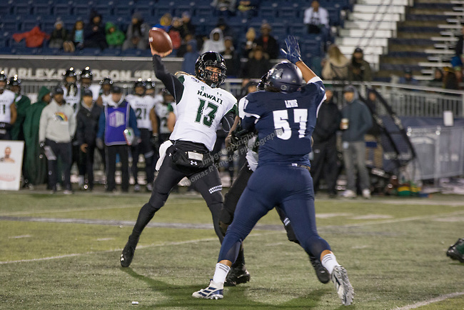 Hawaii quarterback Cole McDonald (13) throws against Nevada in the second half of an NCAA college football game in Reno, Nev. Saturday, Sept. 28, 2019. (AP Photo/Tom R. Smedes)