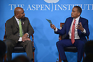 Washington, DC - April 8, 2014: Fox News political analyst Juan Williams (r) directs a question to Philadelphia Mayor Michael Nutter during the Aspen Institute's 'Symposium on The State Race in America' at the Newseum in the District of Columbia. (Photo by Don Baxter/Media Images International)