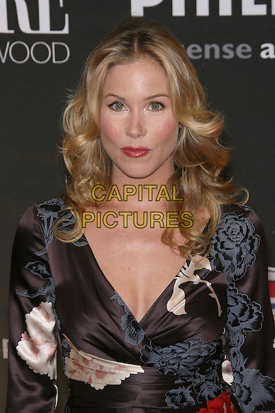 CHRISTINA APPLEGATE.The 13th Annual Premiere Women In Hollywood held at the Beverly Hills Hotel, Beverly Hills, California, USA..September 20th, 2006.Ref: ADM/ZL.half length black dress floral print .www.capitalpictures.com.sales@capitalpictures.com.©Zach Lipp/AdMedia/Capital Pictures.