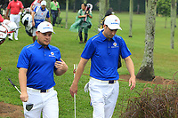 Terrell Hatton (Europe) and Ross Fisher (Europe) walking to the 2nd tee during the Friday Foursomes of the Eurasia Cup at Glenmarie Golf and Country Club on the 12th January 2018.<br /> Picture:  Thos Caffrey / www.golffile.ie