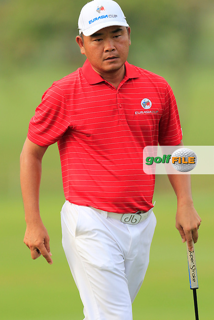 Danny Chia (MAY) Team Asia on the 1st green during Match 1 of Friday's Fourball Matches of the 2016 Eurasia Cup presented by DRB-HICOM, held at the Glenmarie Golf &amp; Country Club, Kuala Lumpur, Malaysia. 15th January 2016.<br /> Picture: Eoin Clarke | Golffile<br /> <br /> <br /> <br /> All photos usage must carry mandatory copyright credit (&copy; Golffile | Eoin Clarke)