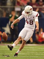 STAFF PHOTO BEN GOFF  @NWABenGoff -- 09/27/14  Arkansas backup kicker Adam McFain kicks off to Texas A&M during the first quarter of the Southwest Classic in AT&T Stadium in Arlington, Texas on Saturday September 27, 2014.