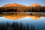 Chaos Crags and Mount Lassen at sunset reflection in calm water of Manzanita Lake, Lassen Volcanic National Park, California