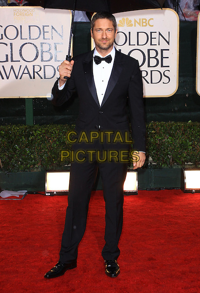 GERARD BUTLER .67th Golden Globe Awards held Beverly Hilton, Beverly Hills, California, USA..January 17th, 2010.globes full length black tuxedo umbrella .CAP/ADM/KB.©Kevan Brooks/Admedia/Capital Pictures
