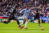 Huddersfield Town's forward Steve Mounie (24) breaks past Crystal Palace's defender Mamadou Sakho (12)  during the EPL - Premier League match between Huddersfield Town and Crystal Palace at the John Smith's Stadium, Huddersfield, England on 17 March 2018. Photo by Stephen Buckley / PRiME Media Images.