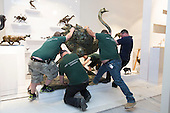 London, UK. 20 June 2015. Sculptor Mark Coreth's life-size ostrich sculpture is moved into place by Art Logistics Ltd at the stand of Sladmore Contemporary for the Masterpiece art fair. The ostrich weighs more than 500kg. Masterpiece London is a leading international cross-collecting fair for art, antiques and design. It takes place at The Royal Hospital Chelsea from 25 June – 1 July.