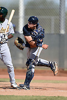 Milwaukee Brewers catcher Dustin Houle (16) throws down to second during an Instructional League game against the Oakland Athletics on October 10, 2013 at Maryvale Baseball Park Training Complex in Phoenix, Arizona.  (Mike Janes/Four Seam Images)