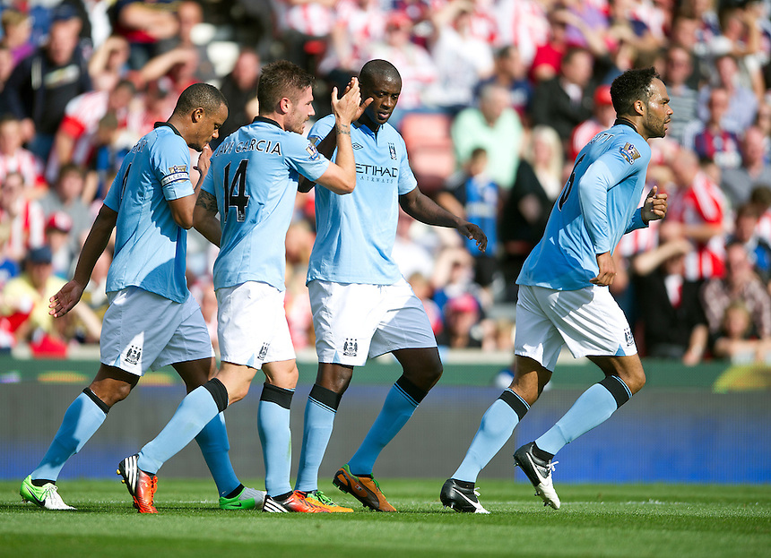 Manchester City's Javi Garcia celebrates scoring his sides equalising goal to make the score 1-1 with team-mate Yaya Toure ..Football - Barclays Premiership - Stoke City v Manchester City - Saturday 15th September 2012 - Britannia Stadium - Stoke..