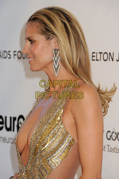 Heidi Klum (wearing Julien Macdonald).21st Annual Elton John Academy Awards Viewing Party held at West Hollywood Park, West Hollywood, California, USA..February 24th, 2013.oscars half length gold diamante sequins sequined dress beads beaded art deco plunging neckline cleavage dangling earrings side profile hair slicked back.CAP/ADM/BP.©Byron Purvis/AdMedia/Capital Pictures.