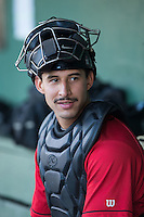 Kannapolis Intimidators catcher Seby Zavala (21) sits in the dugout while his team is at bat during the game against the Hagerstown Suns at Kannapolis Intimidators Stadium on May 4, 2016 in Kannapolis, North Carolina.  The Intimidators defeated the Suns 7-4.  (Brian Westerholt/Four Seam Images)