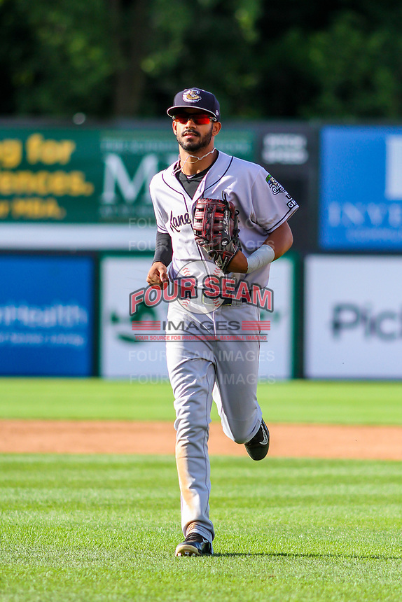 Kane County Cougars outfielder Luis Silverio (15) jogs in from the oufield between innings during game one of a Midwest League doubleheader against the Wisconsin Timber Rattlers on June 23, 2017 at Fox Cities Stadium in Appleton, Wisconsin.  Kane County defeated Wisconsin 4-3. (Brad Krause/Four Seam Images)