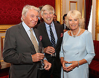 12 July 2016 - London, England - Camilla, Duchess of Cornwall, chats with photographer Don McCullin as she hosts the 30th Anniversary Garden Party for the National Osteoporosis Society in St James Palace in London. Due to inclement weather the event was moved indoors. The Duchess of Cornwall has been connected with the charity for nearly 30 years. Photo Credit: ALPR/AdMedia