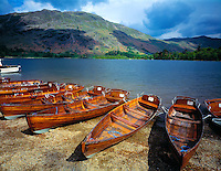 Boats at Ullswater Lake Lake District National Park, England United Kingdom  Mountains of the Lake District beyond  May