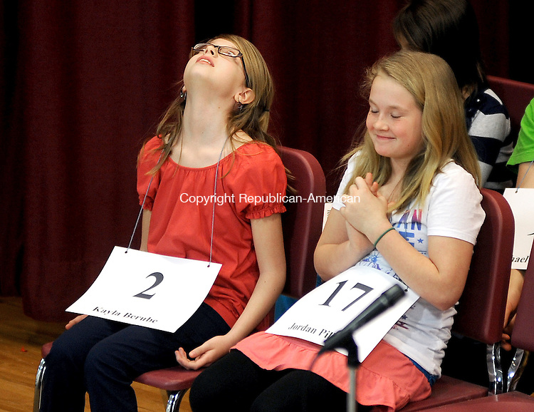 "PLYMOUTH, CT, 05 APRIL  2012-040512JS01-Contestants Kayla Berube, left, and Jordan Pilbin, right, react after finding out they both moved on to the next round during the second annual Terryville-Plymouth PTSA Council Spelling Bee Thursday at Plymouth Center School. Pilbin was the eventual winner in the 21st round after spelling ""Establish"". Berube was runner-up..Jim Shannon Republican-American"