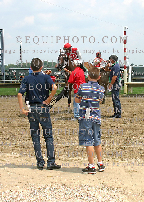 Trainer Cal Lynch with his two sons in the winner's after winning the second race at Parx Racing in Bensalem, Pennsylvania July July 23, 2012.  Photo By Barbara Weidl/EQUI-PHOTO