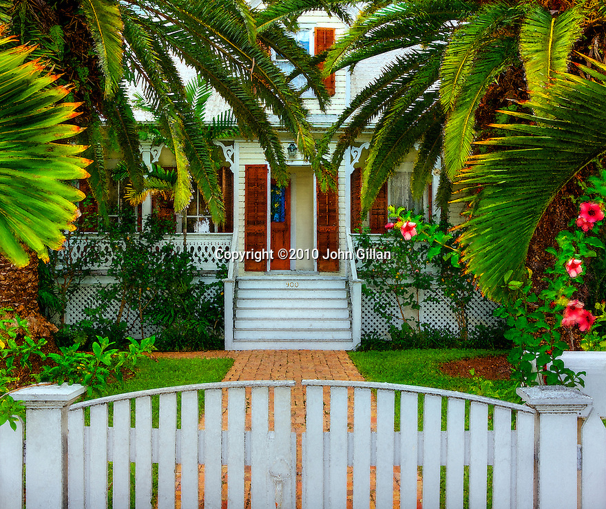 Front porch and tropical landscaping of a home in Key West, Florida