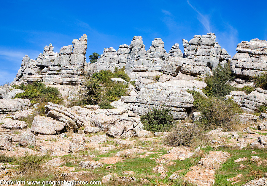 Dramatic limestone scenery of rocks shaped by erosion and weathering at El Torcal de Antequera national park, Andalusia, Spain.