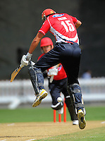 Canterbury's Peter Fulton leaps out of the way of Rob Nicol's drive. HRV Cup Twenty20 cricket - Wellington Firebirds v Canterbury Wizards at Allied Nationwide Finance Basin Reserve, Wellington. Sunday, 5 December 2010. Photo: Dave Lintott / lintottphoto.co.nz