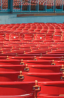 The red chair backs in the Pritzker Pavillion create a pattern of red in Millennium Park in Chicago, Illinois