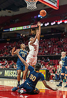 COLLEGE PARK, MD - NOVEMBER 20: Kaila Charles #5 of Maryland crashes into Neila Luma #30 of George Washington as she shoots during a game between George Washington University and University of Maryland at Xfinity Center on November 20, 2019 in College Park, Maryland.