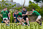 Iveragh Eagles Odhran O'Mahony breaks Dunmanways line but a tackle from Sean Masterson ends the run.