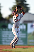 Auburn Doubledays shortstop Osvaldo Abreu (7) tracks down an infield pop up during a game against the Batavia Muckdogs on August 27, 2014 at Dwyer Stadium in Batavia, New York.  Auburn defeated Batavia 6-4.  (Mike Janes/Four Seam Images)