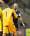 Raith Rovers' keeper David McGurn has words with Hearts' Jamie Hamill at the end of the game.